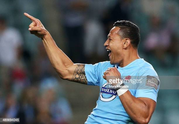 Israel Folau of the Waratahs celebrates scoring a try during the round 10 Super Rugby match between the Waratahs and the Bulls at Allianz Stadium on...