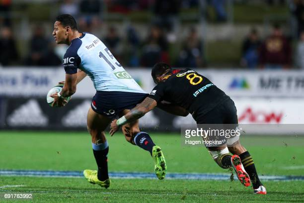 Israel Folau of the Waratahs is caught by Liam Messam of the Chiefs during the round 15 Super Rugby match between the Chiefs and the Waratahs at...