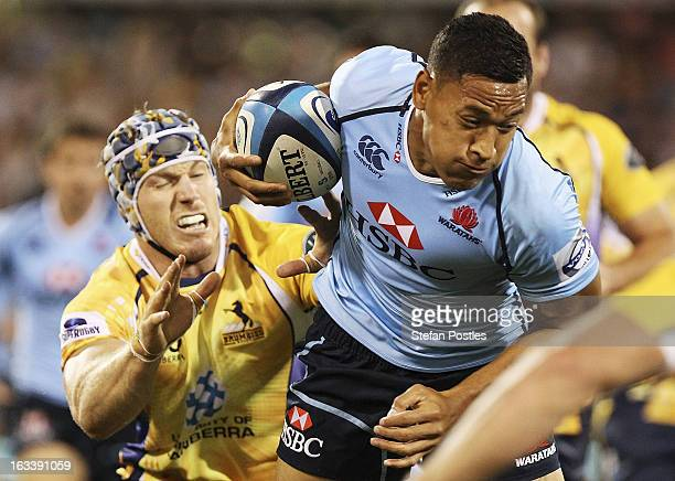 Israel Folau of the Waratahs is tackled by David Pocock of the Brumbies during the round four Super Rugby match between the Brumbies and the Waratahs...