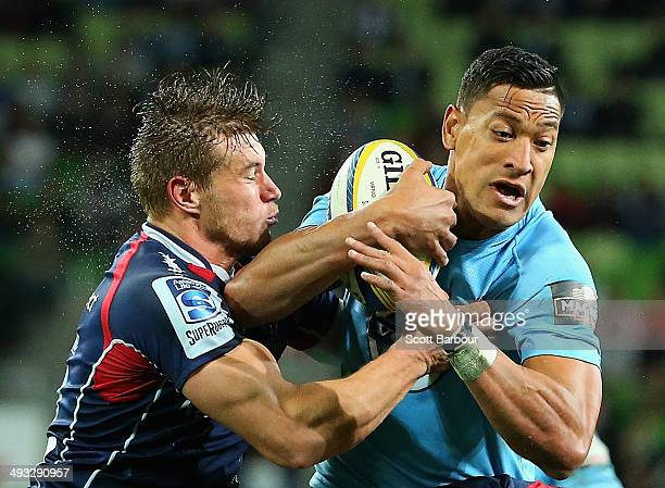 Israel Folau of the Waratahs is tackled by Jason Woodward of the Rebels during the round 15 Super Rugby match between the Rebels and the Waratahs at...