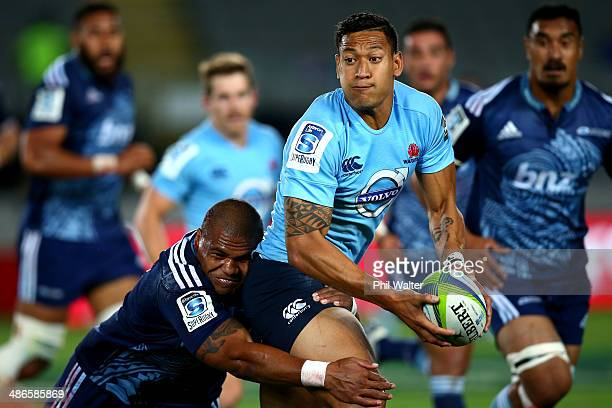 Israel Folau of the Waratahs is tackled by Peter Saili of the Blues during the round 11 Super Rugby match between the Blues and the Waratahs at Eden...