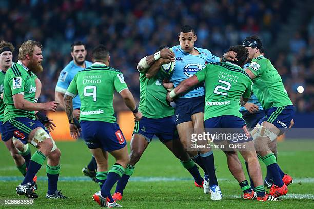 Israel Folau of the Waratahs is tackled by the Highlander's defence during the semifinal match between the New South Wales Waratahs and the...