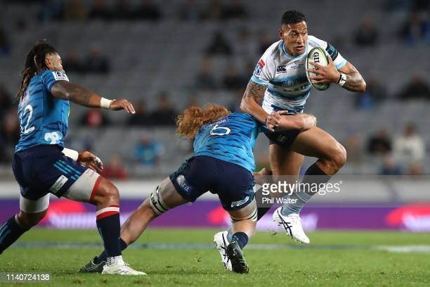 Israel Folau of the Waratahs is tackled by Tom Robinson of the Blues during the round 8 Super Rugby match between the Blues and Waratahs at Eden Park...