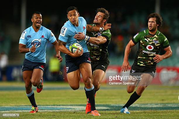 Israel Folau of the Waratahs is tackled during the round 10 Super Rugby match between the Waratahs and the Bulls at Allianz Stadium on April 19 2014...