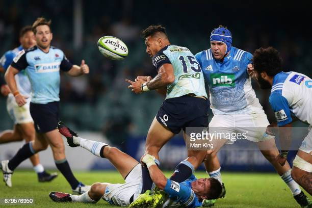 Israel Folau of the Waratahs is tackled during the round 11 Super Rugby match between the Waratahs and the Blues at Allianz Stadium on May 6 2017 in...