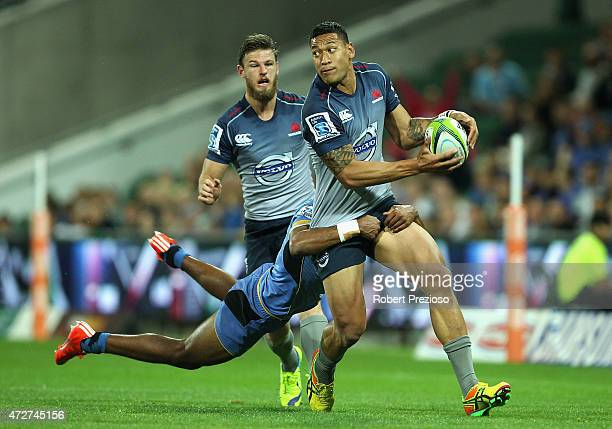 Israel Folau of the Waratahs is tackled during the round 13 Super Rugby match between the Force and the Waratahs at nib Stadium on May 9 2015 in...