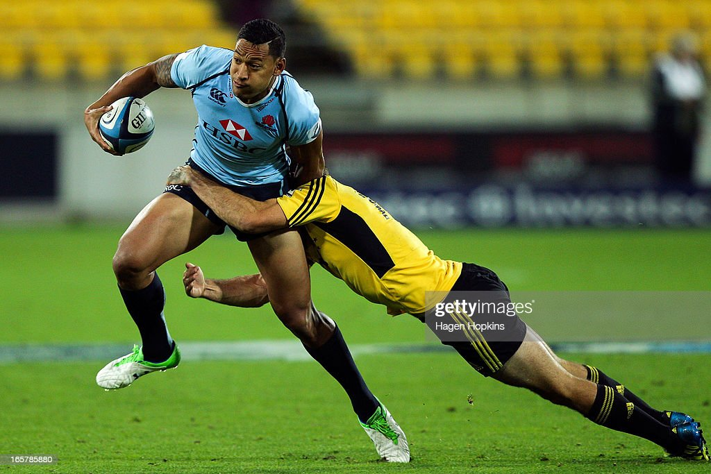 Israel Folau of the Waratahs is tackled during the round eight Super Rugby match between the Hurricanes and the Waratahs at Westpac Stadium on April 6, 2013 in Wellington, New Zealand.