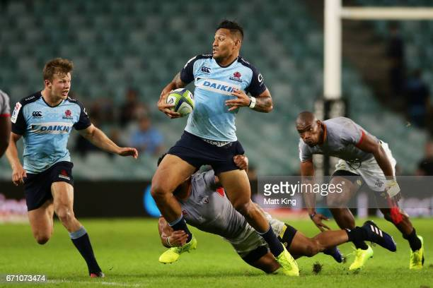 Israel Folau of the Waratahs is tackled during the round nine Super Rugby match between the Waratahs and the Kings at Allianz Stadium on April 21...