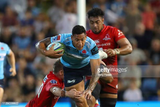Israel Folau of the Waratahs is tackled during the round seven Super Rugby match between the Waratahs and the Sunwolves at McDonald Jones Stadium on...