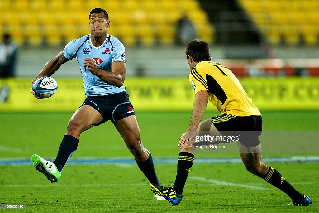 Israel Folau of the Waratahs looks to step Conrad Smith of the Hurricanes during the round eight Super Rugby match between the Hurricanes and the Waratahs at Westpac Stadium on April 6, 2013 in Wellington, New Zealand.