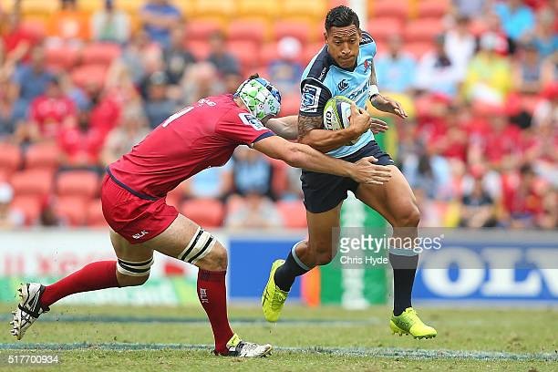 Israel Folau of the Waratahs makes a break during the round five Super Rugby match between the Reds and the Waratahs at Suncorp Stadium on March 27...