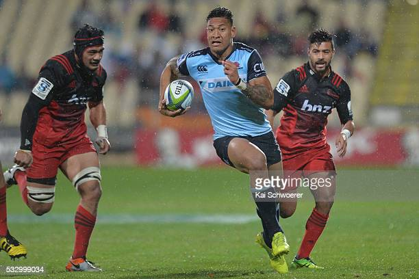 Israel Folau of the Waratahs makes a breakthrough during the round 13 Super Rugby match between the Crusaders and the Waratahs at AMI Stadium on May...