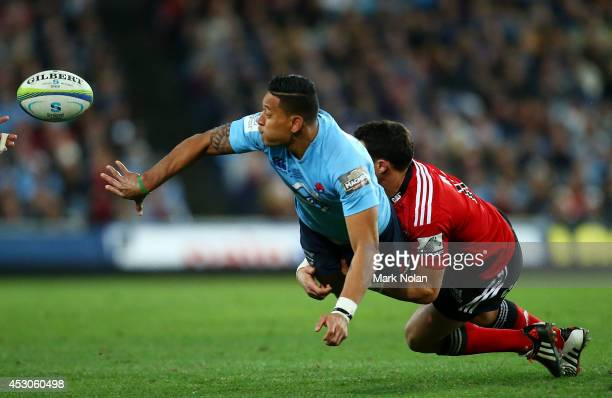 Israel Folau of the Waratahs offloads during the Super Rugby Grand Final match between the Waratahs and the Crusaders at ANZ Stadium on August 2 2014...