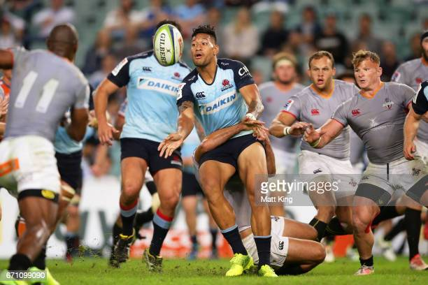 Israel Folau of the Waratahs offloads the ball in a tackle during the round nine Super Rugby match between the Waratahs and the Kings at Allianz...