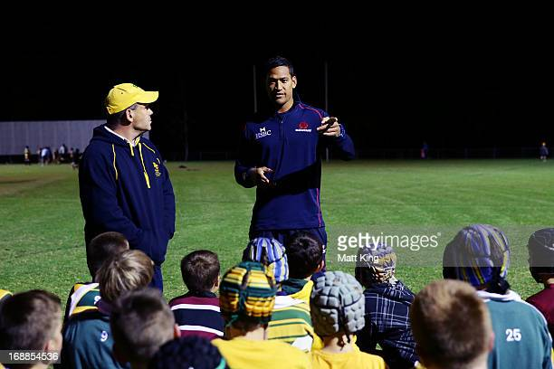 Israel Folau of the Waratahs participates with players from the BeecroftCherrybrook JRUFC during the Waratahs 'Tahs Together' community program at...