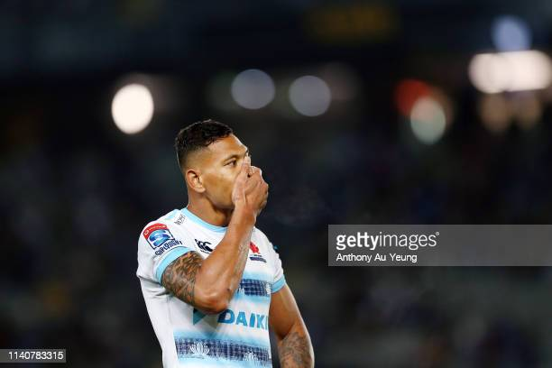 Israel Folau of the Waratahs reacts during the round 8 Super Rugby match between the Blues and Waratahs at Eden Park on April 06 2019 in Auckland New...