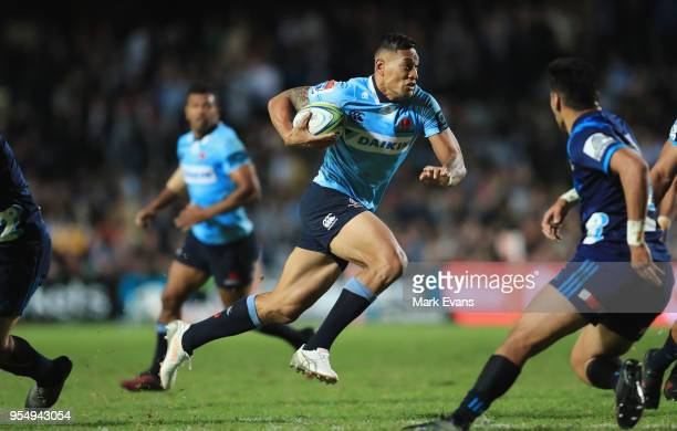 Israel Folau of the Waratahs runs the ball during the round 12 Super Rugby match between the Waratahs and the Blues at Lottoland on May 5 2018 in...