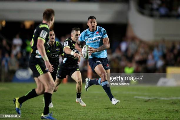 Israel Folau of the Waratahs runs the ball during the round one Super Rugby match between the Waratahs and the Hurricanes at Brookvale Oval on...