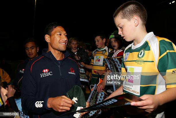 Israel Folau of the Waratahs signs autographs after participating with players from the BeecroftCherrybrook JRUFC during the Waratahs 'Tahs Together'...