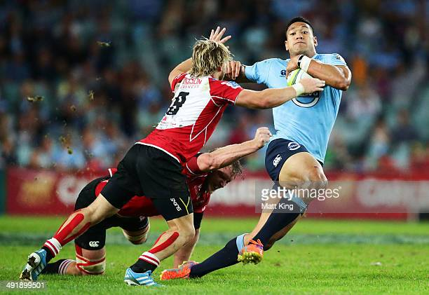 Israel Folau of the Waratahs takes on the defence during the round 14 Super Rugby match between the Waratahs and the Lions at Allianz Stadium on May...