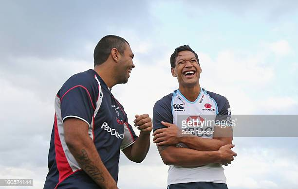 Israel Folau of the Waratahs talks with Kurtley Beale of the Rebels after the Super Rugby trial match between the Waratahs and the Rebels at North...