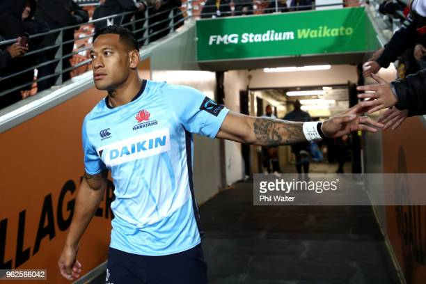 Israel Folau of the Waratahs walks onto the field for the round 15 Super Rugby match between the Chiefs and the Waratahs at FMG Stadium on May 26...