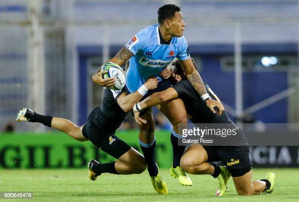 Israel Folau of Waratahs is tackled by Joaquin Tuculet of Jaguares during a match between Jaguares and Waratahs as part of fourth round of Super...