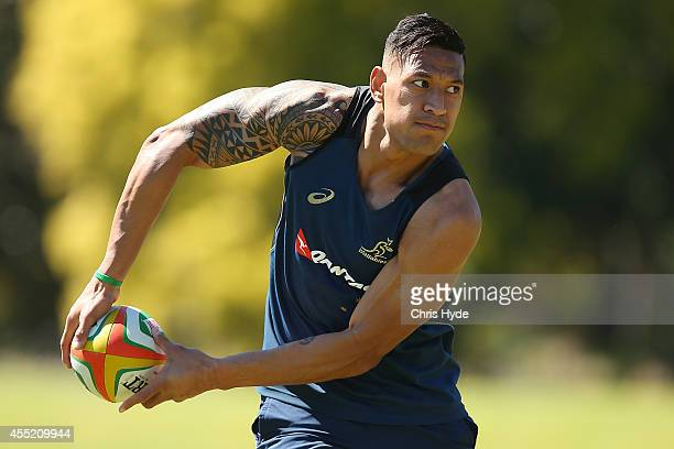 Israel Folau passes during an Australian Wallabies training session at the Palms Sports Fields on September 11 2014 in Gold Coast Australia