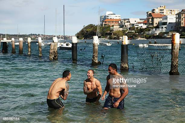 Israel Folau Quade Cooper and Wycliff Palu of the Wallabies recover with a swim following an Australian Wallabies training session at Little Manly...