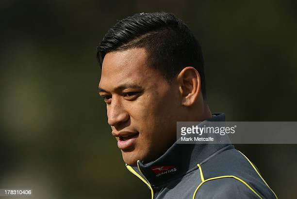 Israel Folau takes part in a development clinic following a press conference at Fairfield High School on August 29, 2013 in Sydney, Australia.