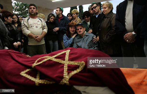 Friends and relatives of slain 57yearold Israeli Faina Slutzker mourn during her funeral 15 November 2006 at the cemetery of the southern Israeli...