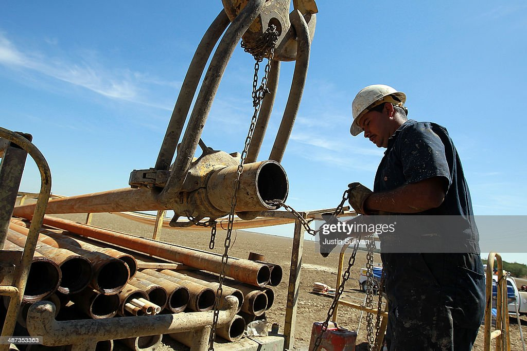 Israel Garcia with Arthur & Orum Well Drilling prepares to install a new pipe on a rig while drilling a new well at a farm on April 29, 2014 near Mendota, California. As the California drought continues, Central California farmers are hiring well drillers to seek water underground for their crops after the U.S. Bureau of Reclamation stopped providing Central Valley farmers with any water from the federally run system of reservoirs and canals fed by mountain runoff.