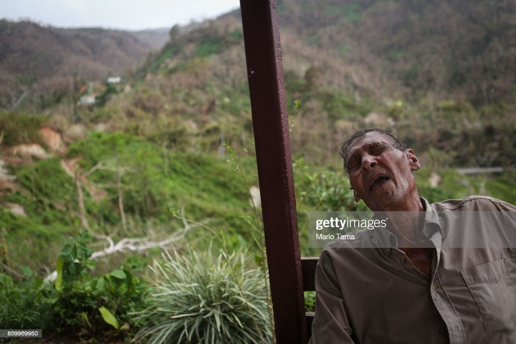 Israel Gonzales, 84, who was diagnosed with terminal cancer, rests after walking up the hillside back to his home after picking coffeee beans to earn extra money, nearly three weeks after Hurricane Maria hit the island, on October 10, 2017 in Pellejas, Adjuntas municipality, Puerto Rico. His house and others in the area have no electricity or running water. Only 16 percent of Puerto Rico's grid electricity has been restored. Puerto Rico experienced widespread damage including most of the electrical, gas and water grid as well as agriculture after Hurricane Maria, a category 4 hurricane, swept through.