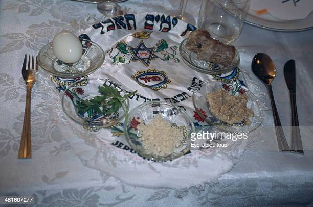 Israel Haifa Passover Seder on table Lamb bone unleavened bread herbs chopped apple mixed with nuts and cinnamon water and salt