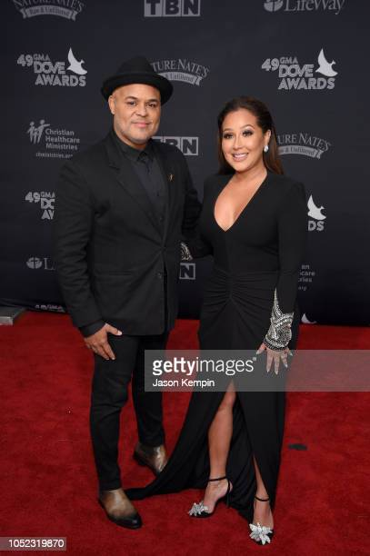 Israel Houghton and Adrienne Bailon attend the 49th Annual GMA Dove Awards at Allen Arena Lipscomb University on October 16 2018 in Nashville...