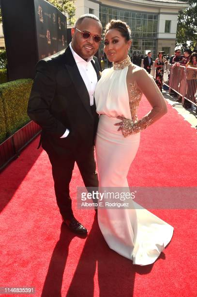 Israel Houghton and Adrienne Houghton attend the 46th annual Daytime Creative Arts Emmy Awards at Pasadena Civic Center on May 03 2019 in Pasadena...