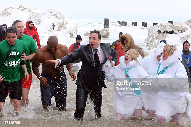 Israel Idonije and Jimmy Fallon participates in the Chicago Polar Plunge 2014 at North Avenue Beach on March 2 2014 in Chicago Illinois