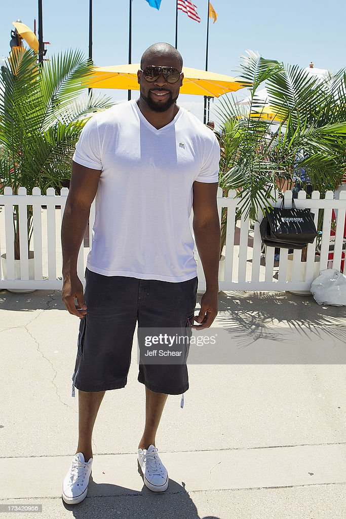 Israel Idonije attends Michigan Avenue Magazine and The Chicago Yacht Club host Ashore Thing presented by BMO Harris Bank on July 13, 2013 in Chicago, Illinois.