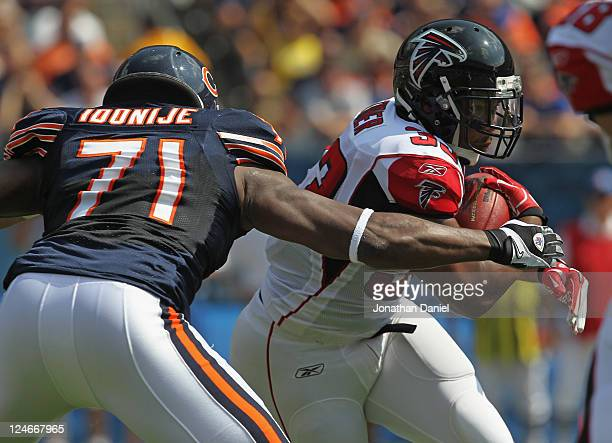 Israel Idonije of the Chicago Bears moves to tackle Michael Turner of the Atlanta Falcons at Soldier Field on September 11 2011 in Chicago Illinois