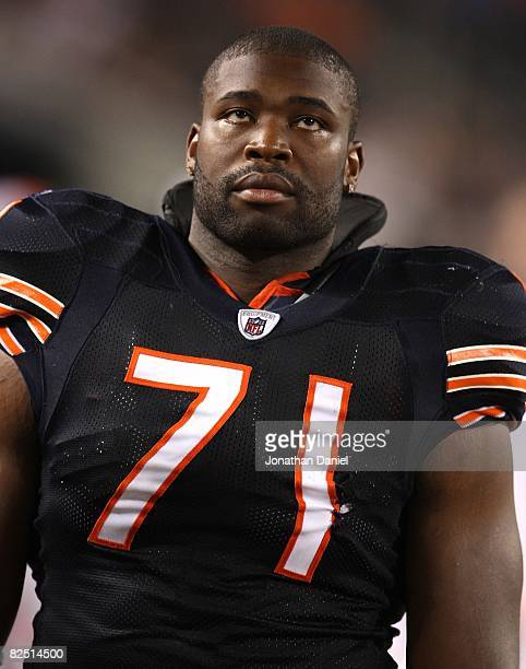 Israel Idonije of the Chicago Bears rests on the sidelines during a game against the San Francisco 49ers on August 21 2008 at Soldier Field in...