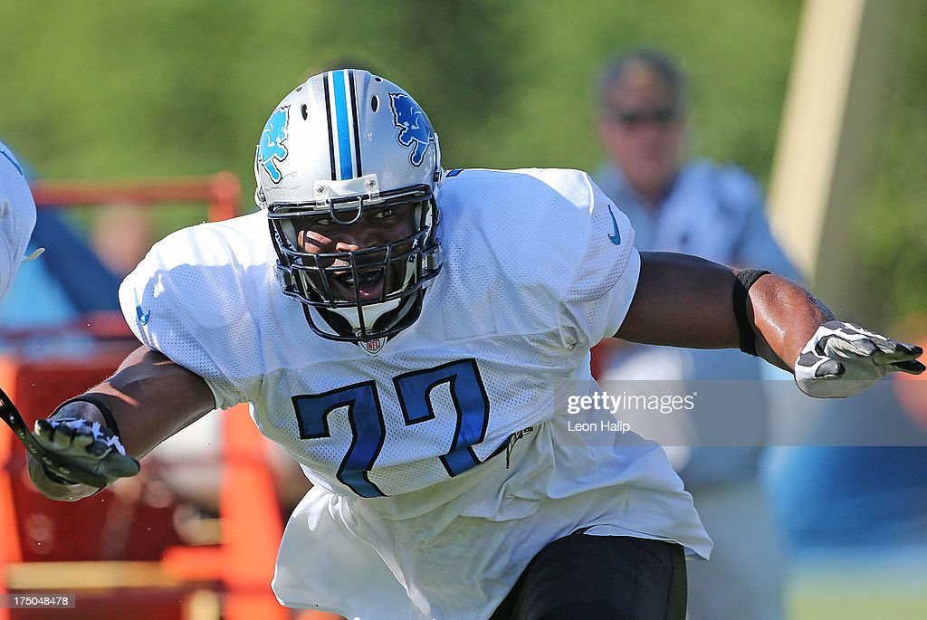 Israel Idonije #77 of the Detroit Lions goes through the morning drills during training camp on July 30, 2013 in Allen Park, Michigan.