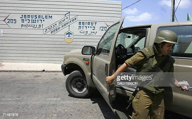 In front of signs giving the distances to Jeruslaem and the Lebanese capital Beirut, an Israeli soldier is seen at the border, now a temporary...