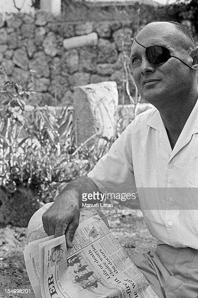 Israel in July 1967 Moshe Dayan in his garden his house has Zahala in the suburbs of Tel Aviv with a daily newspaper