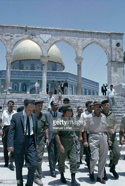 Israel in July 1967 Moshe Dayan visited the Temple Mount in Jerusalem along with military in the background the Dome of the Rock