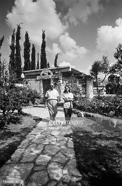 Israel in July 1967 Moshe Dayan was Zahala home in the suburbs of Tel Aviv walking in his garden with his daughter Yael
