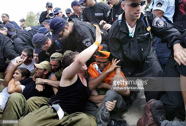 Israeli soldiers acting the role of resisting settlers confront Israeli policemen trying to evacuate them from their homes during a largescale...