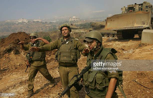 Israeli soldiers are seen on the Lebanese side of the IsraeliLebanon border during an operation to pull out two tanks which were targeted by a...