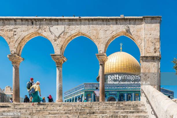 Dome of the rock seen through the arched columns