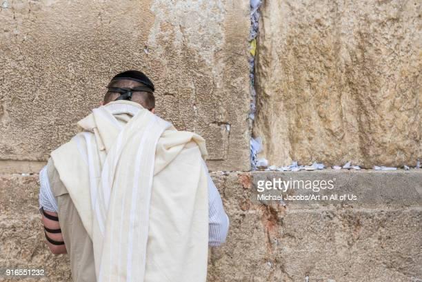 Orthodox jewish man praying at the wailing wall kotel