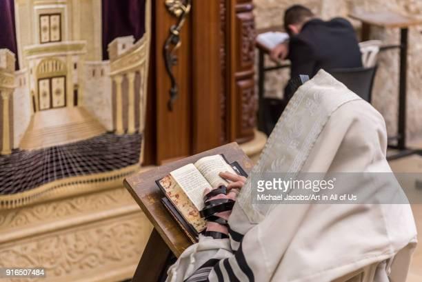 Orthodox jewish men praying at the wailing wall kotel